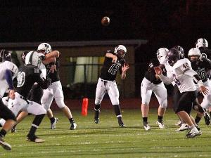 Rock Bridge quarterback Logan Twehouse throws a pass during the second quarter of the 34-0 win against Troy Buchanan High School Friday.